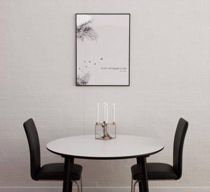 Rund laminat-spisebord i hvid og sort