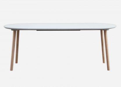 Hvid rund spisebord med udtræk og egetræs ben