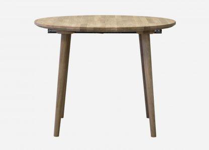 Rundt egetræsbord med udtræk her vist uden tillægsplader